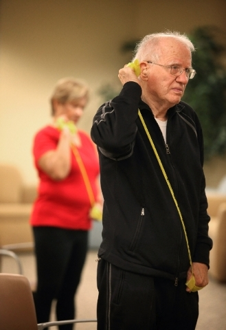 Joey King, 83, works with a resistance band at Southwest Medical Associates Lifestyle Center.