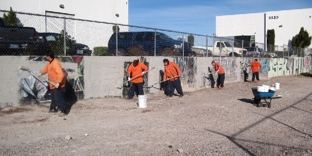 """SPECIAL TO VIEW Clark County Detention Center inmates clean up graffiti in Las Vegas through the Metropolitan Police Department"""";s LV and PD Abatement and Investigation program. Since August ..."""