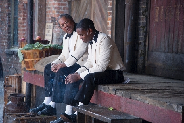 "This film image released by The Weinstein Company shows Clarence Williams, left, and Aml Ameen in a scene from ""Lee Daniels' The Butler."""