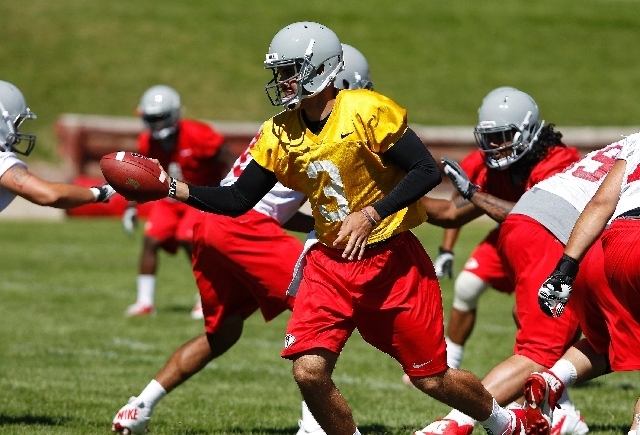 UNLV quarterback Nick Sherry (3) was demoted to second team during training camp because of ball-security issues but since has drawn praise from coach Bobby Hauck. (John Locher/Las Vegas Review-Jo ...