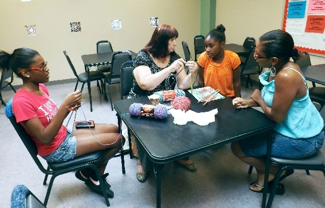 Instructor Joanne Dahl shows Cassidy Johnson how to knit at the Aug. 10 Yarn-a-Thon event at the West Flamingo Senior Center, 6255 W. Flamingo Road. (CAITLYN BELCHER/VIEW)