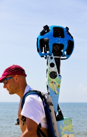 Chris Officer carries a Google street view camera as he walks recording St. George Island beach in the Florida Panhandle.