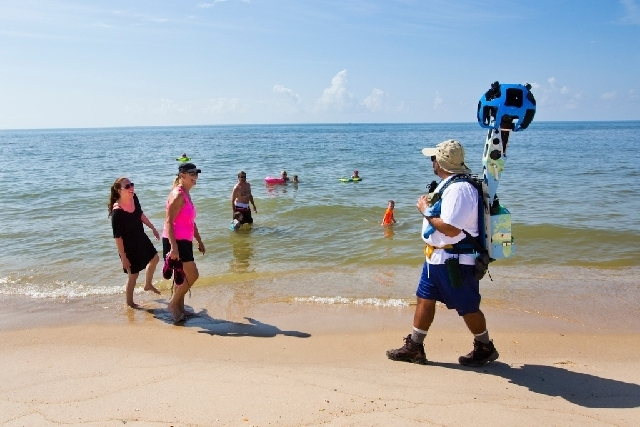 Gregg Matthews carries a Google street view camera as he walks recording St. George Island beach in the Florida Panhandle.