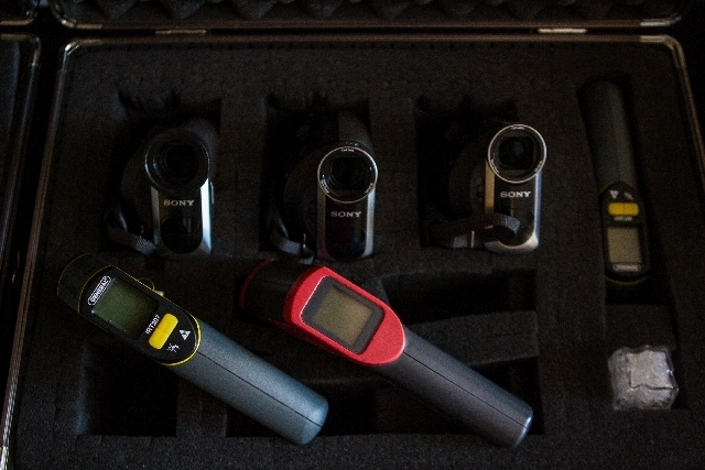 Surveillance cameras and heat detection guns are among the tools of the paranormal investigation trade.