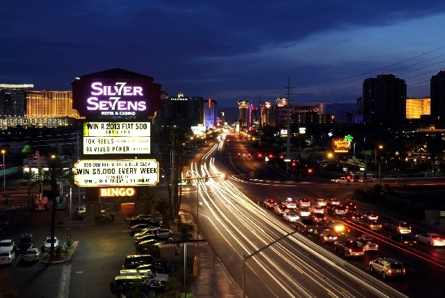 Lights of motor vehicles brighten the night on Flamingo Road near the Strip. Gov. Brian Sandoval is seeking a state study of ways to better fund new road construction in the Silver State, but some ...