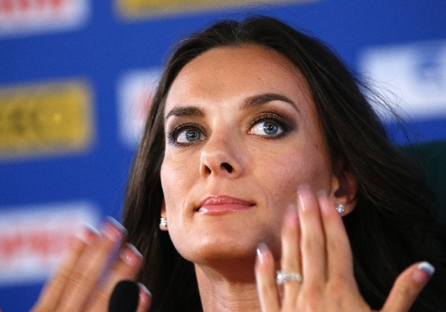 Russia's Yelena Isinbayeva, the gold medalist in the women's pole vault,  gestures during a press conference at the World Athletics Championships.