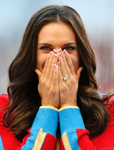 Russia's Yelena Isinbayeva reacts as she stands on the podium after receiving the gold medal in the women's pole vault.