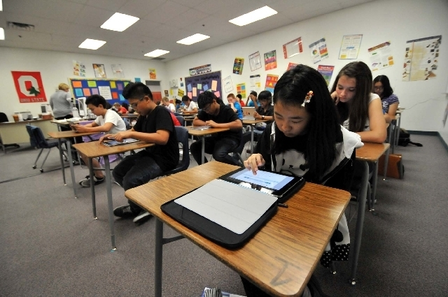 "JEFF MOSIER/VIEW FILE PHOTO Students use iPads in Andrea Keller"";s eighth-grade algebra class at Silvestri Middle School in September 2011, when algebra students at four schools were given t ..."