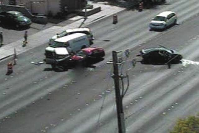 This image taken from a traffic camera shows a five-car crash on Desert Inn Road at Sandhill Road on Thursday.