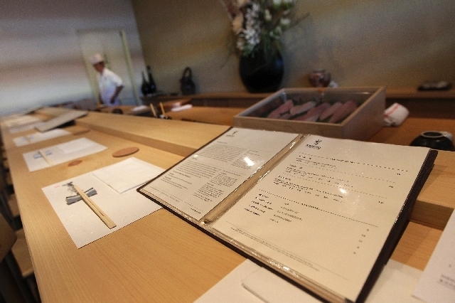 A menu for Kabuto Edomae Sushi Restaurant rests on the sushi bar, which seats 10. The seating capacity for the restaurant is 22. (Jason Bean/Las Vegas Review-Journal)