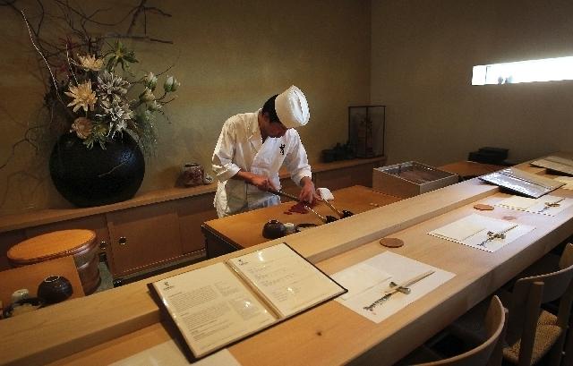 Executive chef Gen Mizoguchi prepares for dinner service at Kabuto Edomae Sushi. Mizoguchi is a second-generation Edomae sushi master. (Jason Bean/Las Vegas Review-Journal)