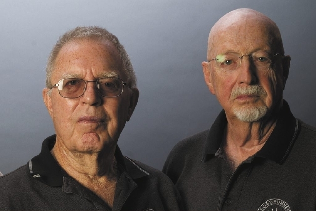 T.D. Barnes, left, and Roger Andersen worked as Central Intelligence Agency contractors at the classified installation known as Area 51 along the dry Groom Lake bed during development of the A-12  ...