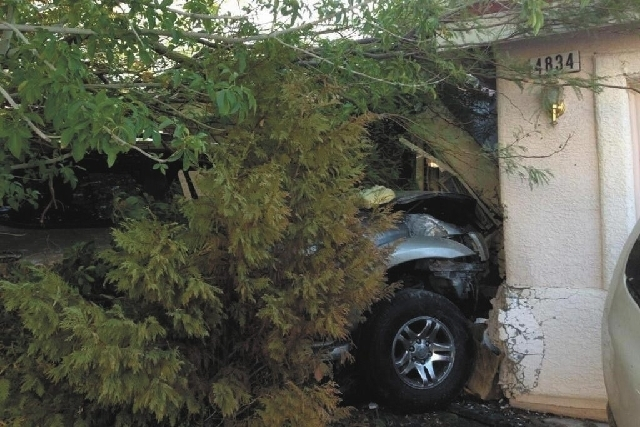The driver of a Toyota Sequoia lost control and struck two houses Friday morning in North Las Vegas, near Lone Mountain Road and Fifth Street. Police say the driver fled on foot and the vehicle ma ...