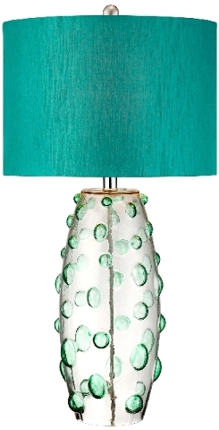 Elements of art deco can be seen in this teal lamp.