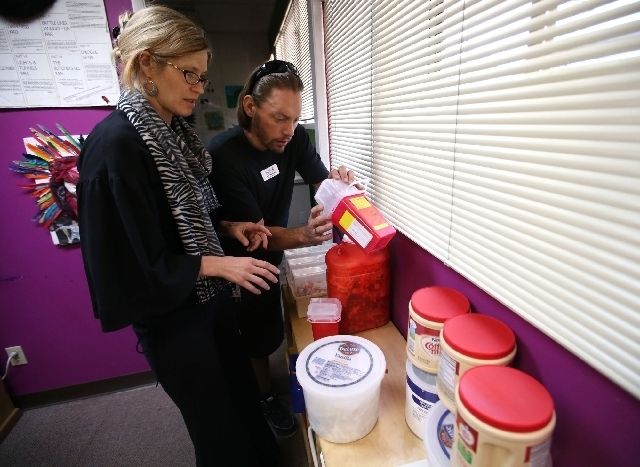 Abigail Polus and John Saderlund work for Northern Nevada Hopes, which will distribute needles and disposal packets to drug users.