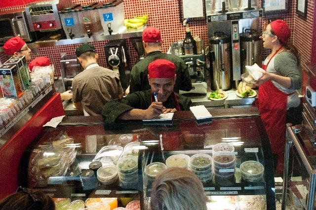 Cesar Ruiz takes an order during lunch service at Bronze Cafe at The Center.