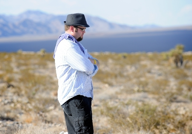 Stephen Langford, brother of missing airman Derek Langford, waits in the desert northwest of Las Vegas on Friday while police investigate a body in a truck. Authorities had been searching the area ...