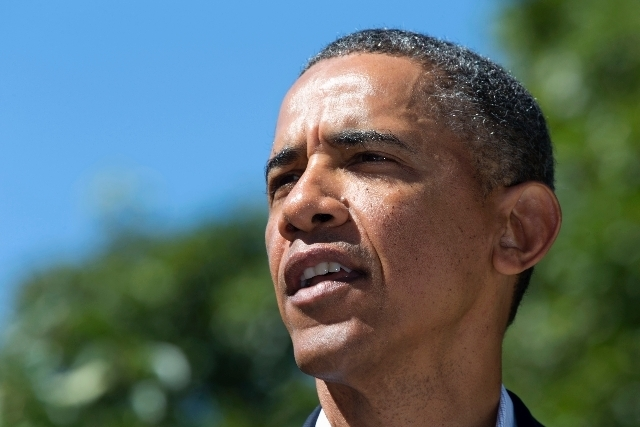 President Barack Obama makes a statement to reporters regarding events in Egypt from his rental vacation home in Chilmark, Mass., on the island of Martha's Vineyard.