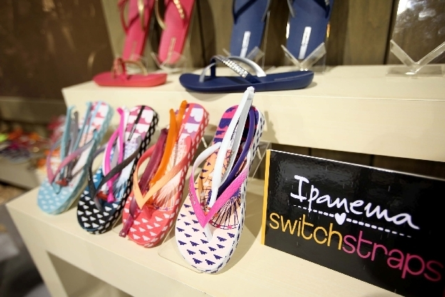 Ipanema Switch Straps flip flops are seen Monday at the Ipanema booth at the Magic Market Week fashion convention at Las Vegas Convention Center. Marketing representative Camila Mosimann was in La ...