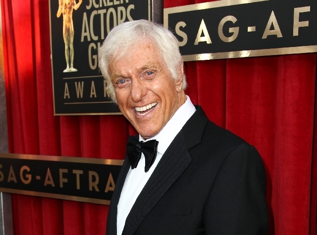 This Jan. 27, 2013 file photo shows actor Dick Van Dyke at the 19th Annual Screen Actors Guild Awards at the Shrine Auditorium in Los Angeles.  Van Dyke is fine after his Jaguar caught fire while  ...