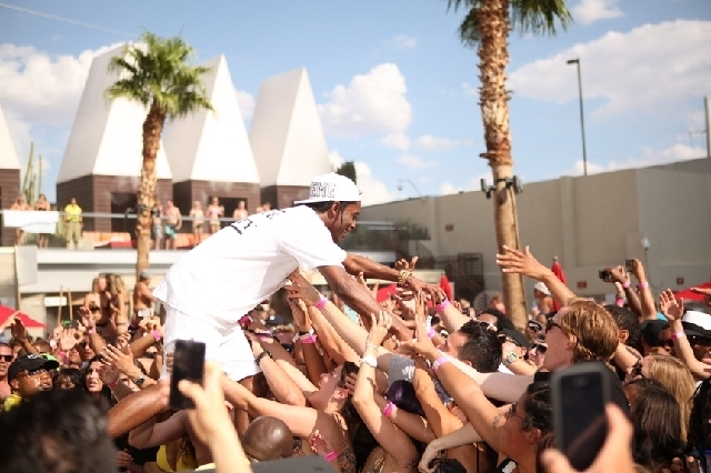 A$AP Rocky high-fived fans while performing at Ditch Fridays at Palms pool last Friday.