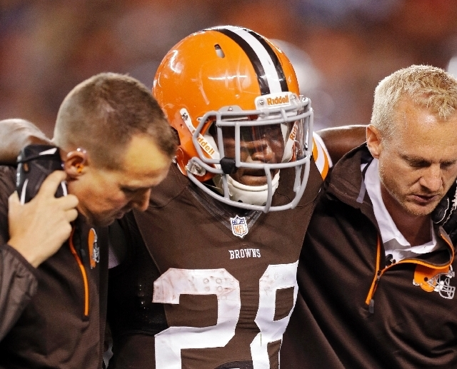 Browns running back Dion Lewis is helped off the field Thursday after suffering a broken left fibula in Cleveland's 24-6 victory over the Lions.(tony dejak/THE ASSOCIATED PRESS)