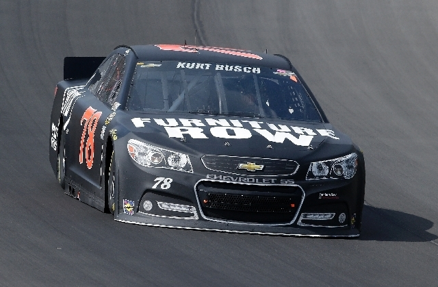 Las Vegas native Kurt Busch races toward a third-place finish in the NASCAR Sprint Cup Series race Sunday at Michigan International Speedway in Brooklyn, Mich.