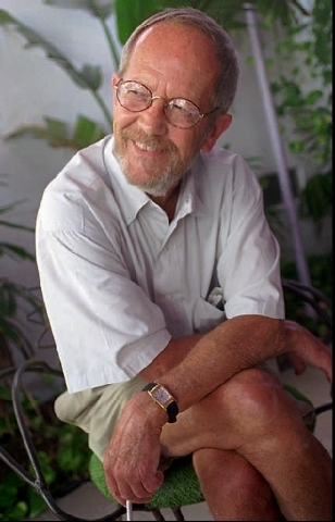 "In this June, 18, 1996 photo, writer Elmore Leonard sits on the set of his latest book-turned movie, ""Pronto,"" in Miami Beach, Fla. Leonard, a former adman who later in life became one of Americ ..."