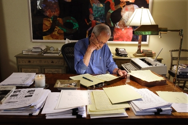 In this Sept. 28, 2010 photo, author Elmore Leonard works on a manuscript at his home in Bloomfield Township, Mich. Leonard, a former adman who later in life became one of America's foremost crim ...