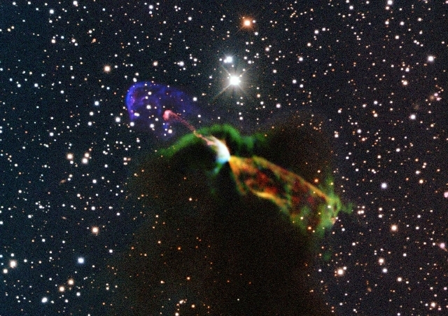 This image, made available by the European Southern Observatory on Tuesday, uses radio and visible light frequencies to show the Herbig-Haro object HH 46/47. Astronomers say these illuminated jets ...