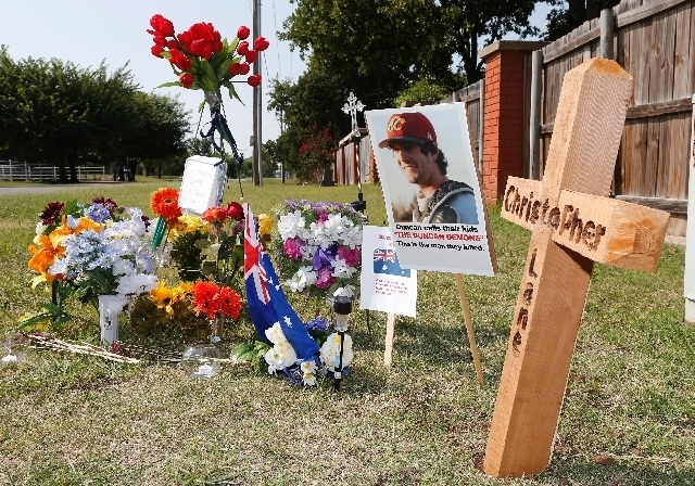 A memorial to Christopher Lane is along the road Tuesday in Duncan, Okla. where he was shot and killed. Lane, an Australian who was on a baseball scholarship at East Central University in Ada, Okl ...
