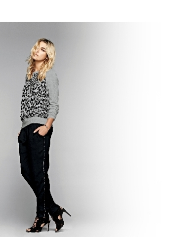 Joie pixelated python print sweatshirt, $244; Joie pants side-piped with matching print, $268; Joie perforated lace-up stilettos, $245, all available at Saks Fifth Avenue.
