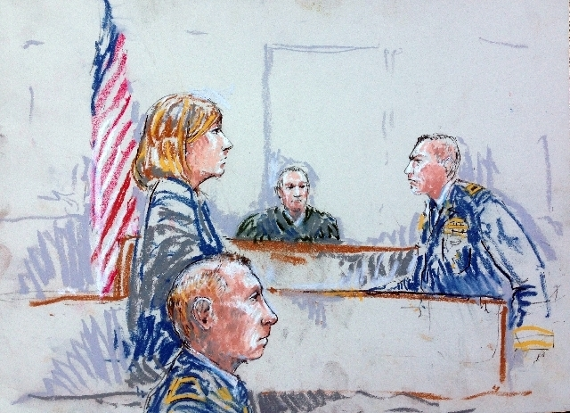 In this courtroom sketch Staff Sgt. Robert Bales, foreground, is seated as prosecutor Lt Col. Jay Morse, right, speaks to the jury in a courtroom at Joint Base Lewis-McChord, Wash. during a senten ...