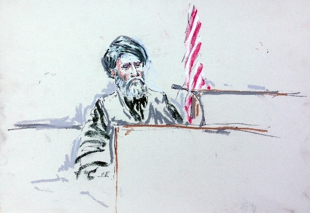 In this courtroom sketch, Haji Mohammad Naim testifies Tuesday in a courtroom at Joint Base Lewis-McChord south of Seattle. (AP Photo/Peter Millett)