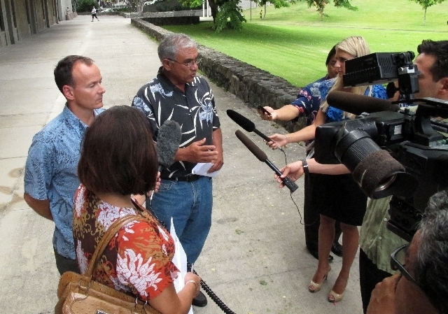 —-Chairman William Aila of the Hawaii Department of Land and Natural Resources, center, speaks to reporters at a news conference in Honolulu on Tuesday, Aug. 20, 2013. Hawaii officials plan  ...