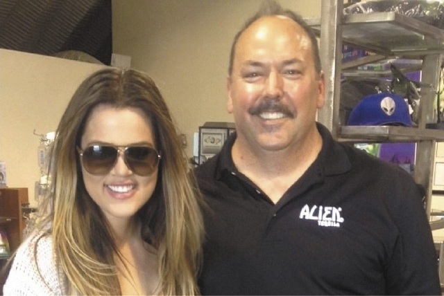 "Ufologist George Harris poses with Khloe Kardashian at his Alien Research Center. Harris says that after chatting with Khloe for 45 minutes, he concluded, ""She truly believes in this stuff.& ..."