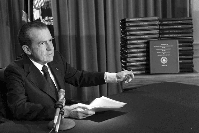 In this April 29, 1974, photo, President Richard M. Nixon points to the transcripts of the White House tapes after he announced during a nationally-televised speech that he would turn over the tra ...
