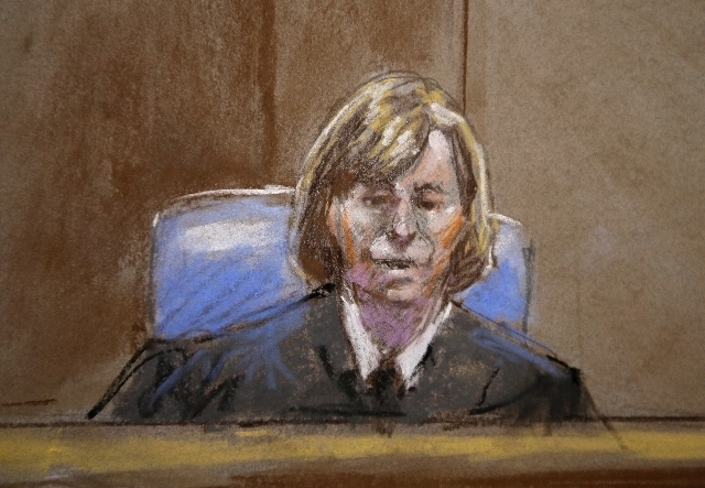 ---In this court room sketch, Judge Col. Tara Osborn, is shown during court proceedings in the court martial of U.S. Army Maj. Nidal Malik Hasan, Wednesday, Aug. 21, 2013, in Fort Hood, Texas. Has ...