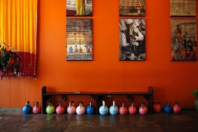 Kettle bells line the walls at Summerlin Yoga. Executive director Stephanie Dixon expanded her class lineup recently to improve business.