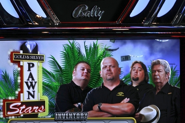 """The """"Pawn Stars"""" slot machine on display September 2012 inside Bally Technologies showroom. Bally is in the process of buying gaming equipment rival SHFL Entertainment."""