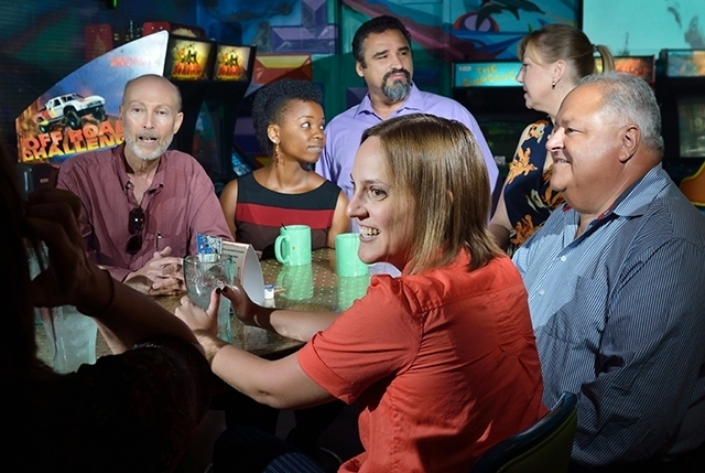The Imagine Communications staff meets at Hi Scores Bar-Arcade on Aug. 19.