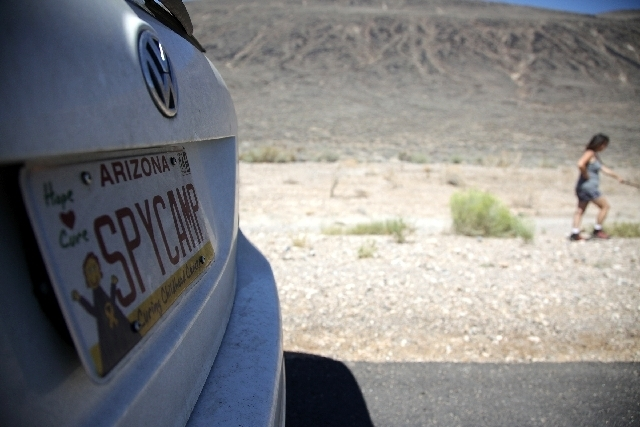 Brenda Priddy tries to come up with new messages for her vanity plates in a playful wink to automotive test crews she follows and photographs each summer in Death Valley. For $750 you can ride alo ...