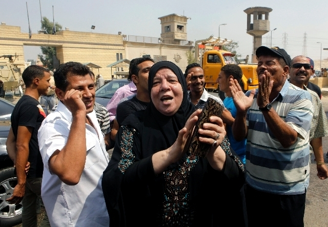 Supporters of Egypt's deposed autocrat Hosni Mubarak chant slogans in front of Tora prison where he is held, in Cairo.