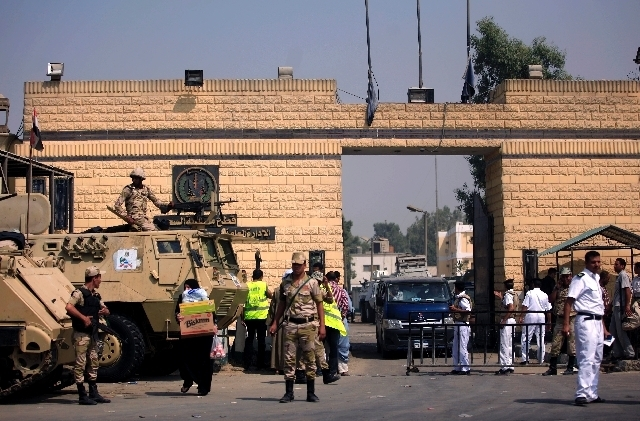 Supporters of Egypt's deposed autocrat Hosni Mubarak chant slogans in front of Tora prison where he is held.