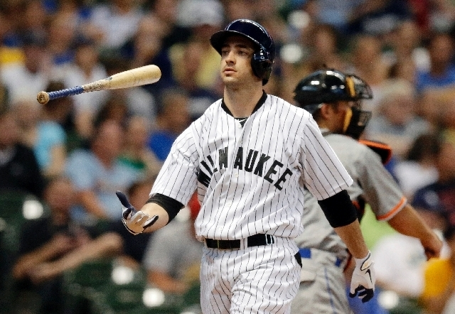 In this July 20, 2013, file photo, Milwaukee Brewers' Ryan Braun flips his bat after striking out during the third inning of a baseball game against the Miami Marlins in Milwaukee. Braun has fina ...