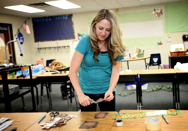 Second-grade teacher Christine Henderson prepares her portable classroom before the start of the school year at Robert L. Forbuss Elementary School in Las Vegas.