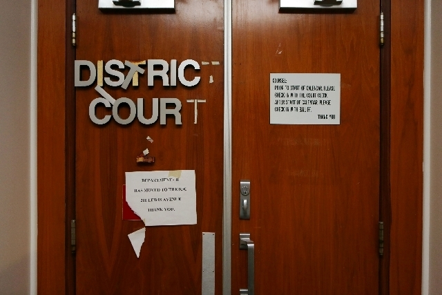 Dilapidated courtroom doors are shown Thursday at Clark County's old courthouse. Nearly eight years after it was shuttered, the building still shows signs of its history.