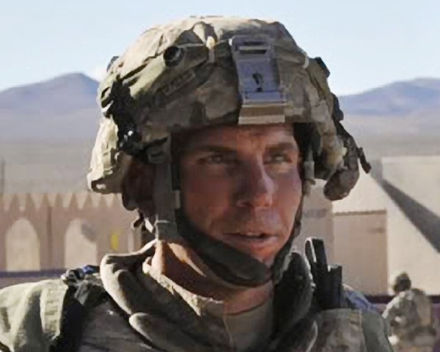 In this Aug. 23, 2011 file Defense Video & Imagery Distribution System photo, Staff Sgt. Robert Bales participates in an exercise at the National Training Center at Fort Irwin, Calif. A military j ...