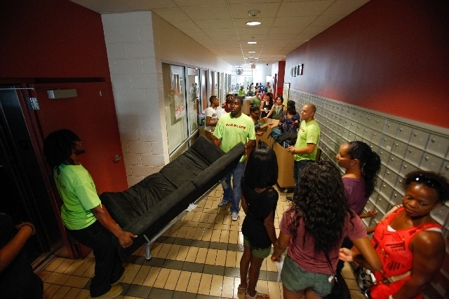 Students, with help from parents and movers, move into their dorms Thursday at the University of Nevada, Las Vegas.