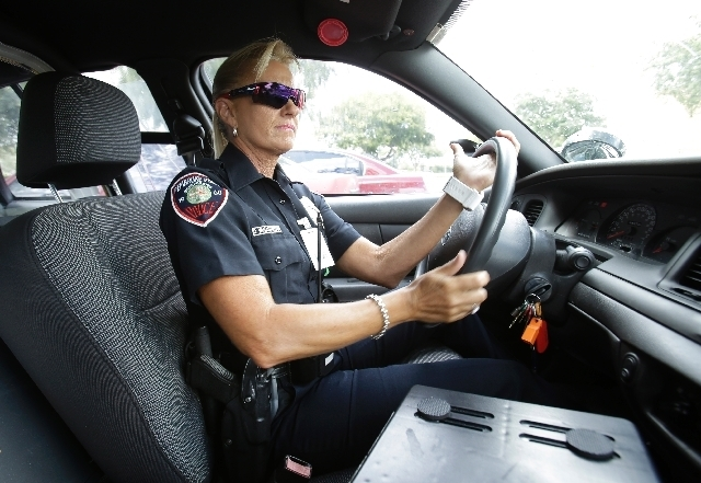 In this photo taken Thursday, Dara Van Antwerp, the school resource officer at Panther Run Elementary School, drives her patrol car in Pembroke Pines, Fla., in the suburbs of Fort Lauderdale. (AP  ...